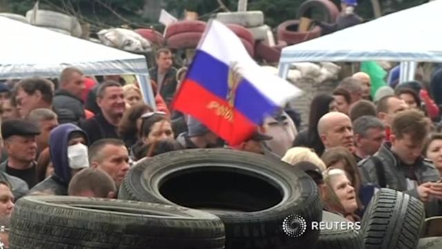 Ukraine in talks with separatists, offers amnesty