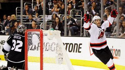 Devils stay alive, beat Kings on late goals