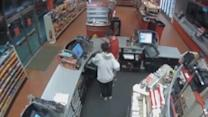 Watch: Woman robs gas station at knifepoint