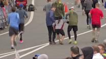 Half-marathon runner carries fatigued woman to finish line
