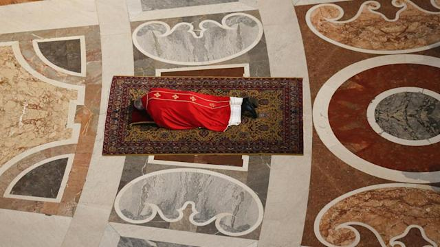 Photos of the Day – Pope Francis Lies Flat to Pray