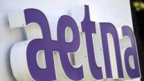 Aetna & Humana rush to deal; Guess lifted; Weight Watchers gain