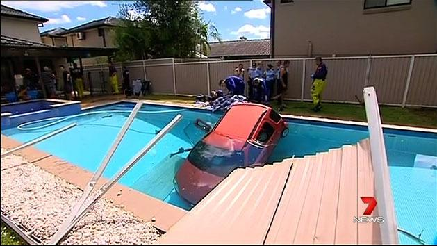 Car ploughs into backyard pool