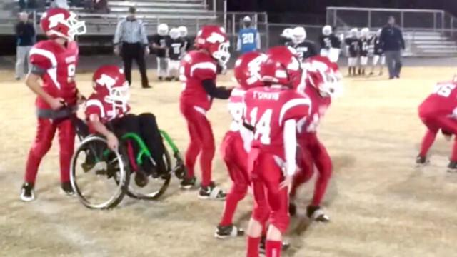 Wheelchair-Bound Boy Fulfills Football Dream