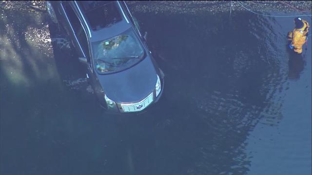 RAW: Crews, divers at scene of car into pond in Arlington Heights