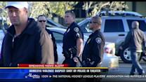 Domestic violence suspect shot by police in theater