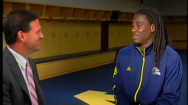 Denard Robinson reacts to Sports Illustrated cover