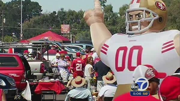 SF 49ers fans celebrate at Candlestick's last opener