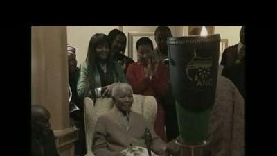 Nelson Mandela is handed ANC flame