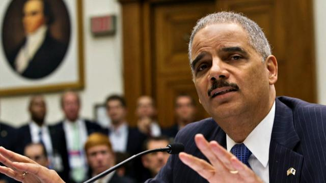 Attorney General Eric Holder visits Ferguson as protests continue