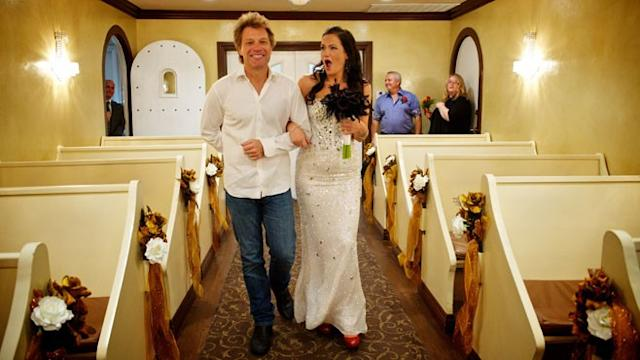 Jon Bon Jovi Walks Fan Down the Aisle