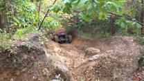 Driver Tries to Drive up Rocky Path