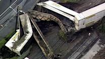 Mudslide forces seven train cars to derail