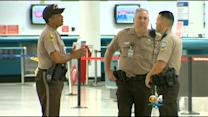 "Passenger Detained After Device With Words ""Bomb"" & ""Tick Tock"" Found At MIA"