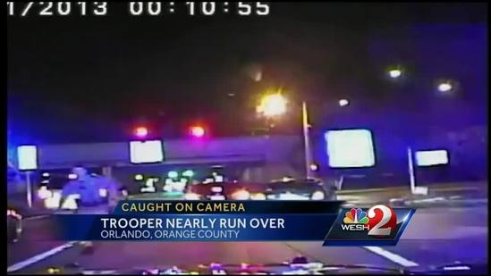 Video shows trooper nearly struck by fleeing car