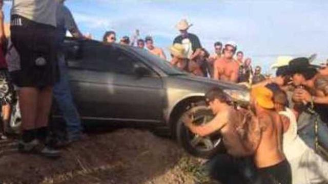 Festival Goers Come Together to Save a Trapped Driver