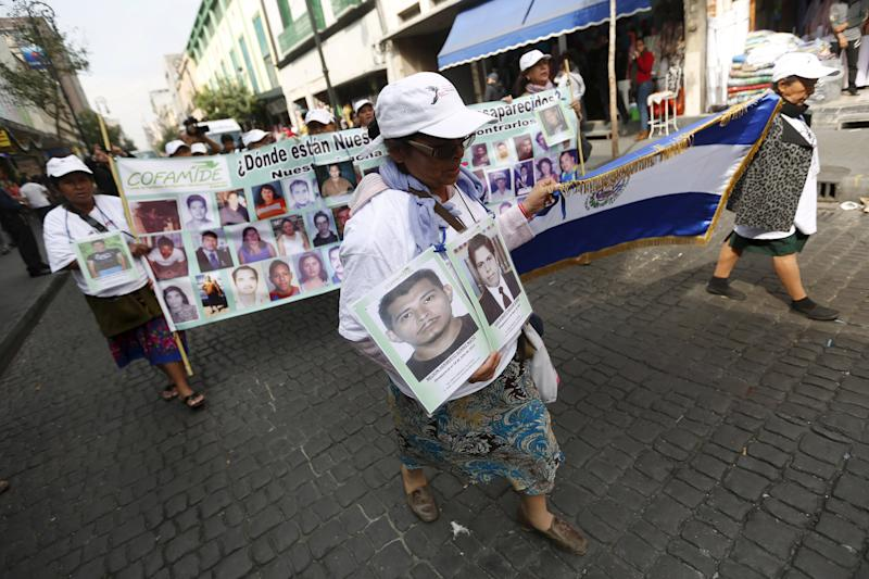 "Women of the ""Caravana de Madres Centroamericanas"" (Caravan of Central American Mothers) hold up photos of missing migrants as they visit La Merced neighborhood during a journey searching their relatives in Mexico City, December 9, 2015. The group, made up of relatives of people from Nicaragua, Honduras, El Salvador and Guatemala who went missing while making their way to the U.S., marched to demand that the governments of Central America stop kidnappings and other crimes committed by organised criminal groups on migrants, according to local media. REUTERS/Edgard Garrido"