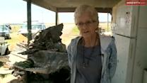 Tornado victims rush to clean up before more storms