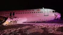 Air Canada plane skids off runway after a hard landing