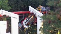 Roller coaster riders hang for hours after car partially derails