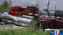 Truck smashed between trains in Channelview