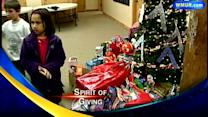 Kids donate Christmas presents to Toys for Tots
