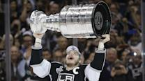 Dustin Brown is handed the Stanley Cup