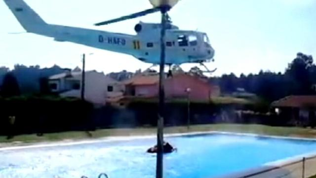 Helicopter Fighting Wildfire Refills From Public Pool