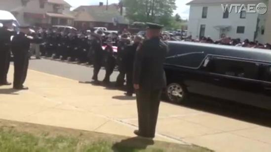 Raw: Bagpipes at Jerry McCarthy funeral