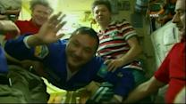 Hugs and smiles as new space station crew clocks in