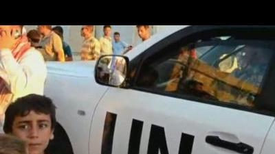 UN Syria monitors in Tremseh