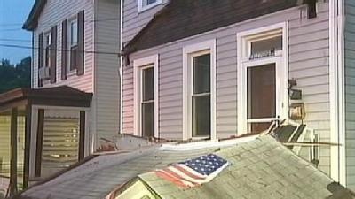 Vehicle Slams Into Home After Police Chase