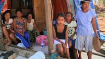 As Philippine 'Tent City' goes up, remote villagers remain without aid