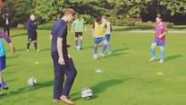 Prince William plays a bit of football at Buckingham Palace