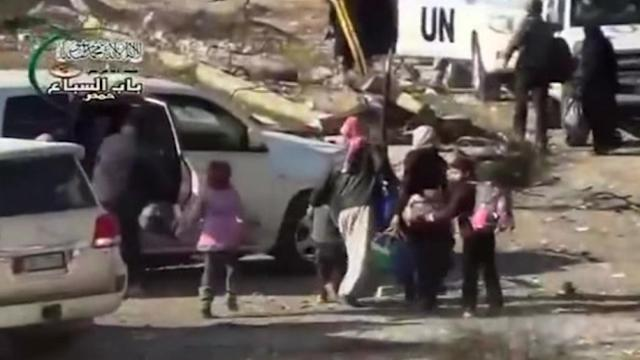 Syrians fleeing Homs attacked