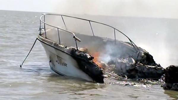 4 rescued from burning boat near Candlestick Point