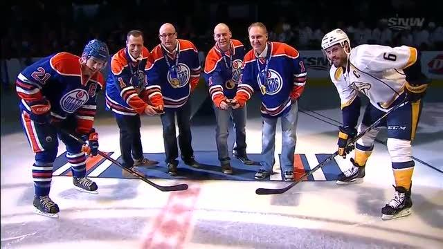 Oilers honor the gold medalist curling team