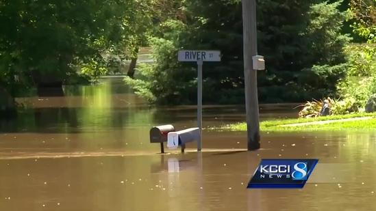 Flooding means some Iowans face commute by canoe