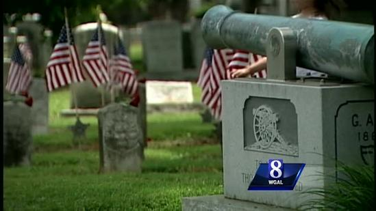 Red rose tribute part of Lancaster cemetery event