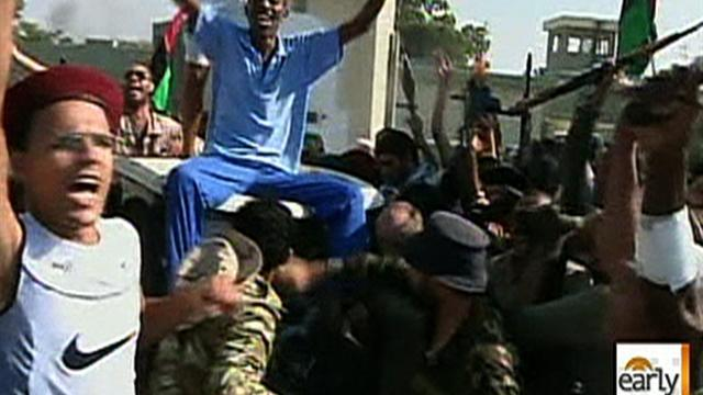 Qaddafi calls on supporters to take back Libya