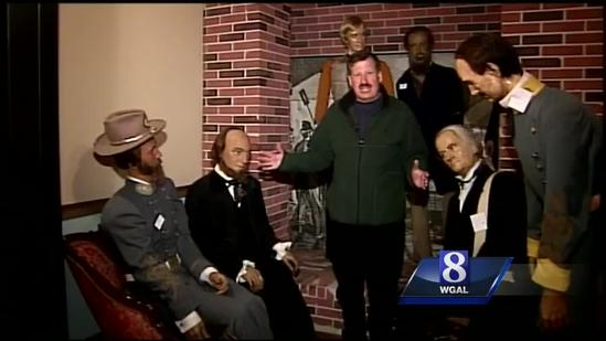 Nearly 100 wax figures up for bid