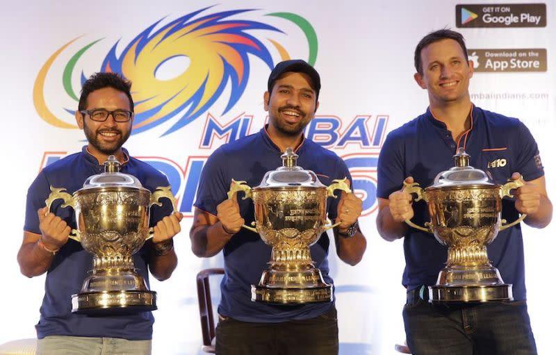 Parthiv Patel, Rohit Sharma and Shane Bond with the three IPL trophies