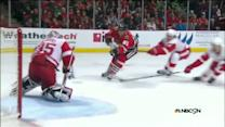 Marian Hossa scores after blowing past the D