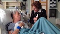 Elderly couple sing to each other in hospital