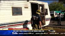 Teen hurt while trying to put out mobile home fire