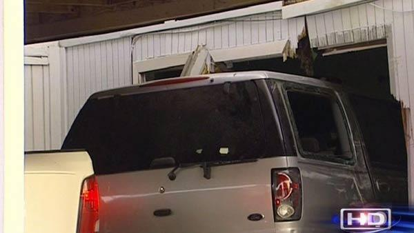 SUV slams into homes in SW Houston