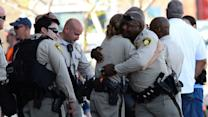 Las Vegas shooting: Search for motive after officers, shopper killed