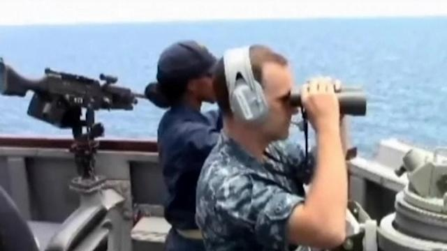 U.S. Navy scans ocean for missing Malaysian Airlines flight.