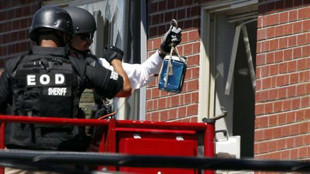 Police working to enter suspect's booby-trapped apartment