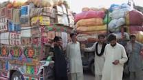 Families displaced by Pakistani airstrikes appeal to government to open roads